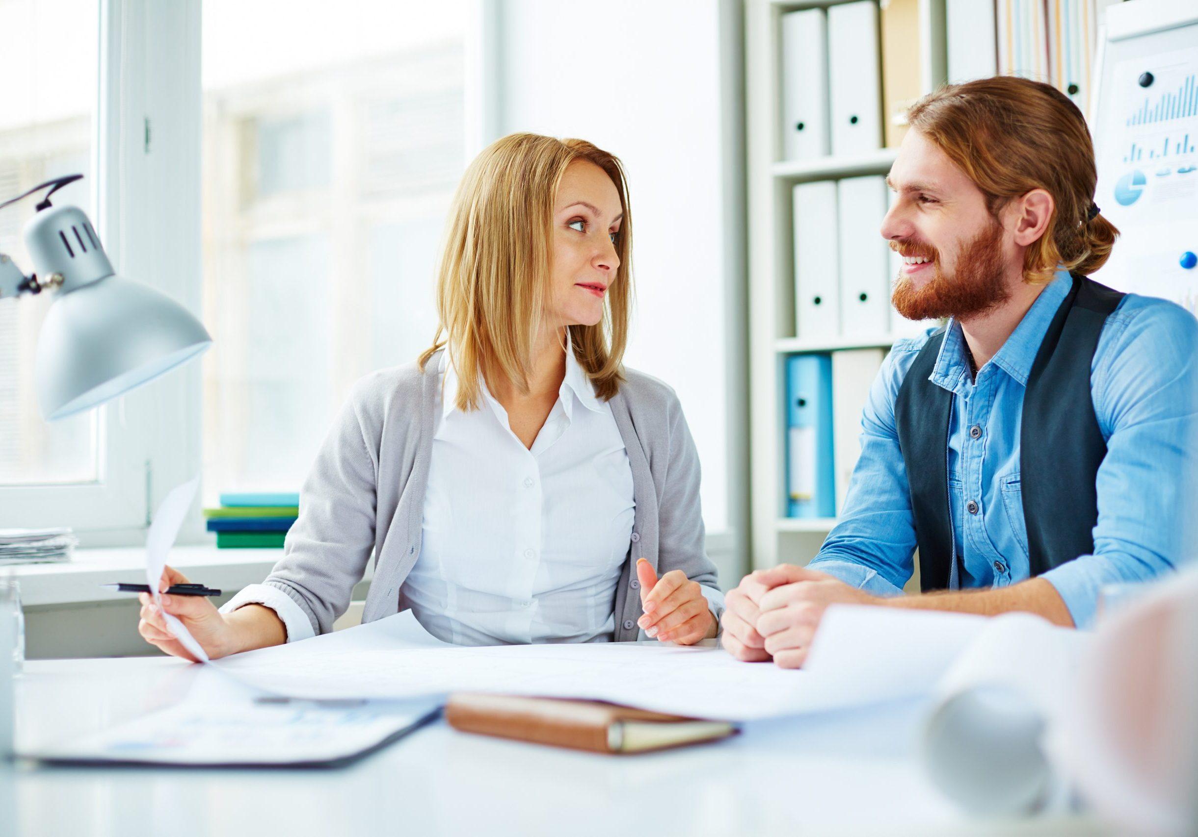 Two business people talking in office