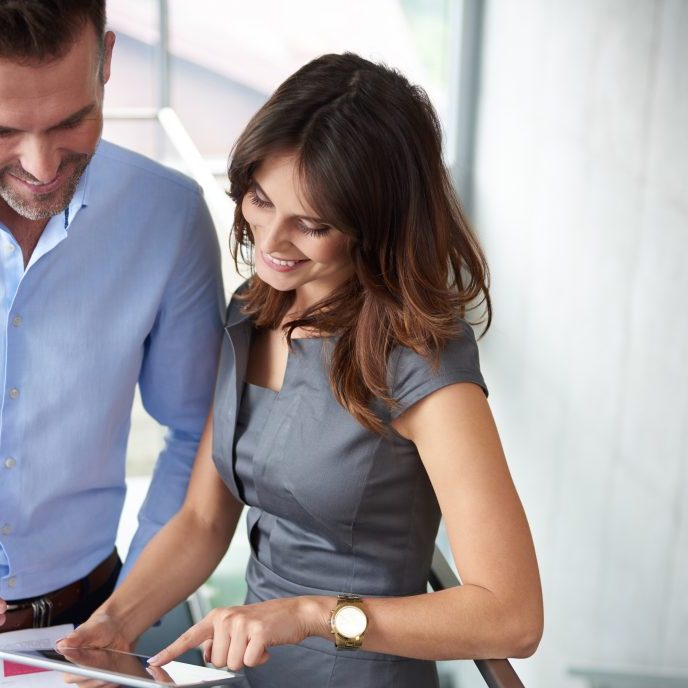 Cheerful business people over documents